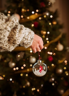 Woman holding bauble in hand
