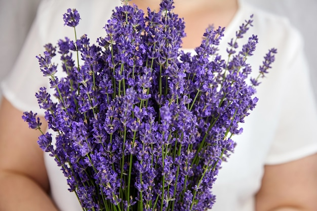 Woman holding beautiful bouquet of fresh lavender flowers close up