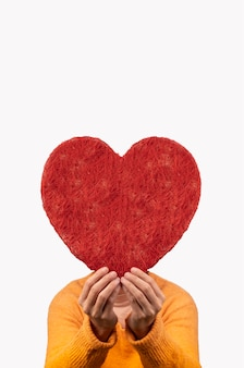 Woman holding big heart between her hands, concept valentines day
