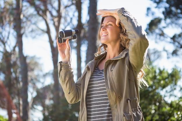 Woman holding binoculars