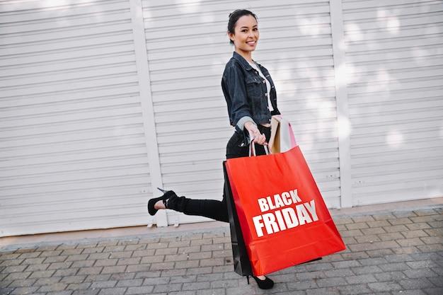 Woman holding a black friday shopping bag