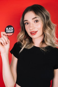 Woman holding black friday sticker