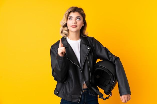 Woman holding a black motorcycle helmet