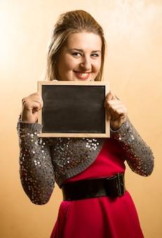 Woman holding blackboard with copyspace