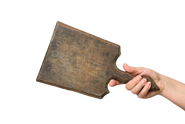 Woman holding blank brown rectangular wooden board in hand