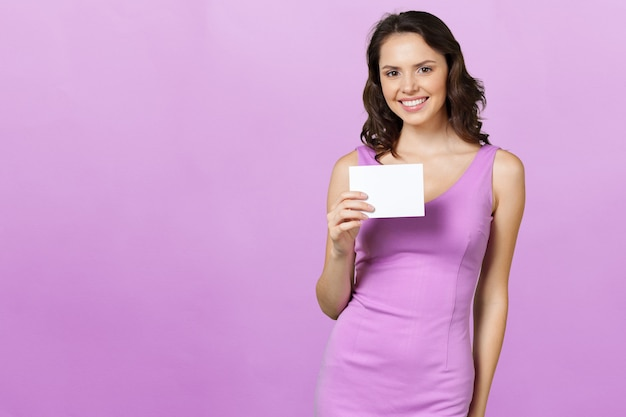 Woman holding blank card.