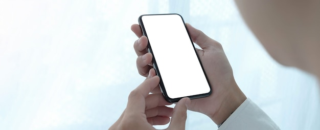 Woman holding blank screen mock up mobile phone