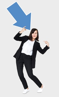 Woman holding a blue arrow and pointing to herself