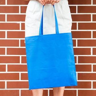 Woman holding a blue bag
