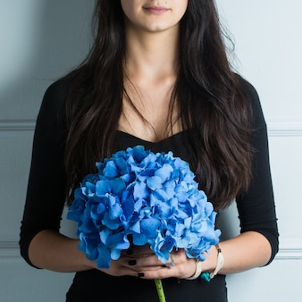 Woman holding a bouquet of sky blue sirens