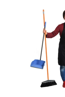 Woman holding broom and dustpan on white