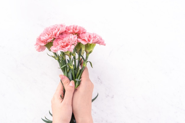 Woman holding bunch of carnation for mother's day gift concept.