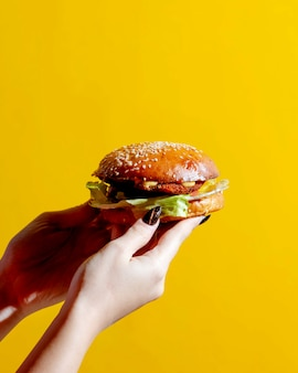 Woman holding burger in her hands