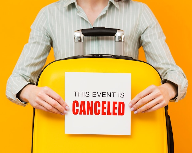 Woman holding a cancelled event card