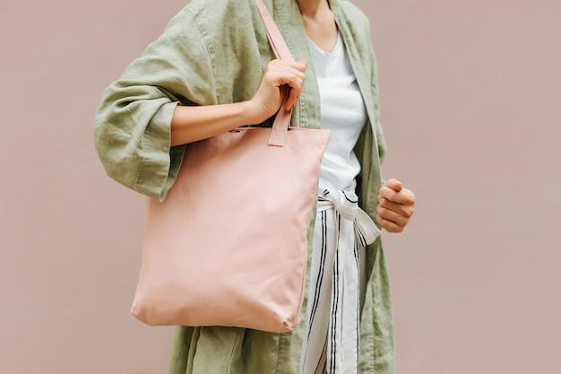 Woman holding canvas tote bag. reusable eco bag. eco friendly concept.