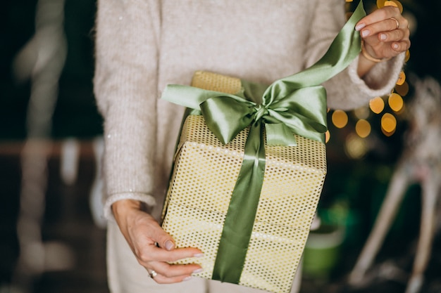 Woman holding a christmas present, box close up