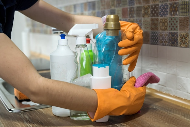 Woman holding cleaning products and products and ready to clean. housework