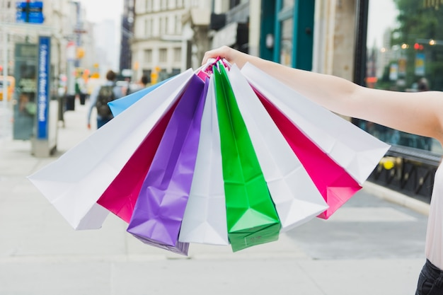 Woman holding colourful shopping bags
