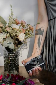 Woman holding a compact camera