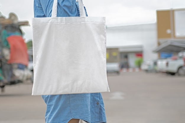 Woman holding cotton bag for shopping. eco concept