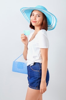 Woman holding credit card summer holiday