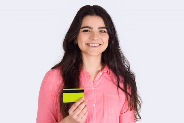 Woman holding credit card.