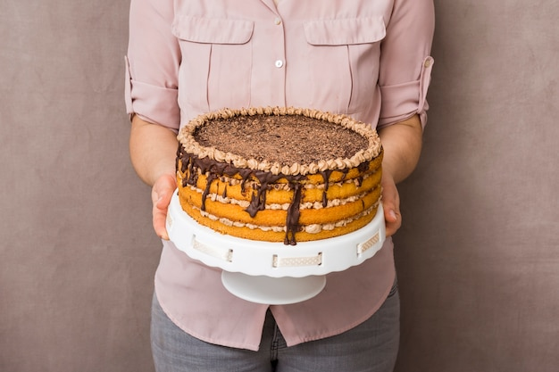 Woman holding delicious cake