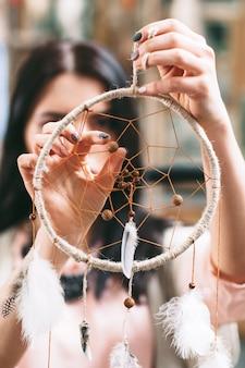 Woman holding dreamcatcher