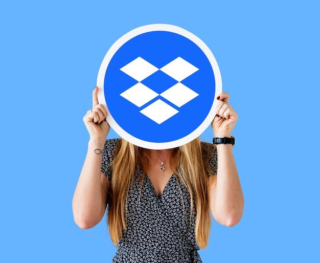 Woman holding a dropbox logo icon