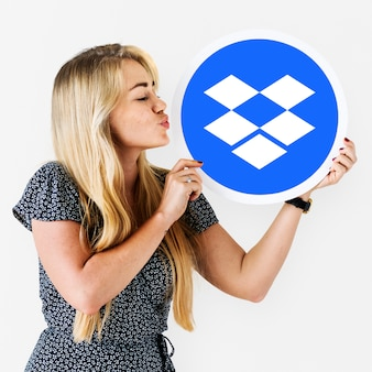 Woman holding a dropbox logo isolated