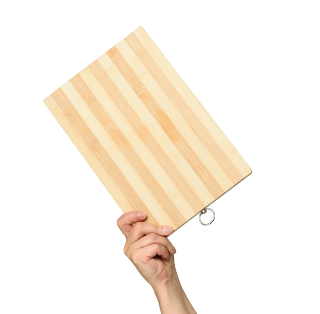 Woman holding empty brown rectangular wooden board in hand, body part on white background