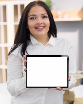 Woman holding an empty screen tablet