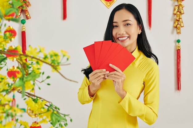 Woman holding envelopes with money