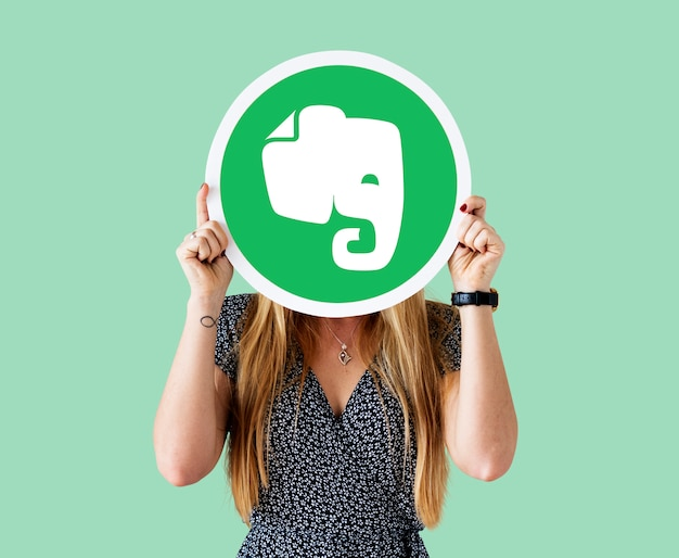 Woman holding an evernote icon