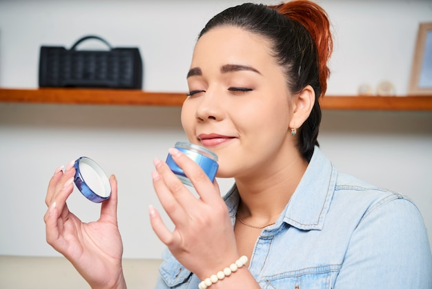 Woman holding face cream