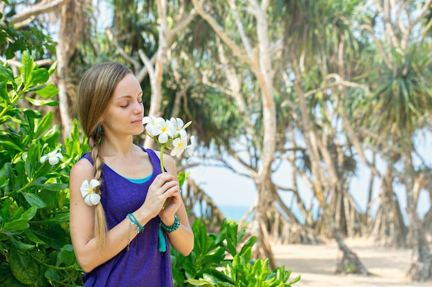 Woman holding a flowers of plumeria