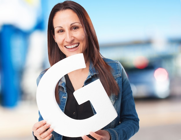 Woman holding the g letter