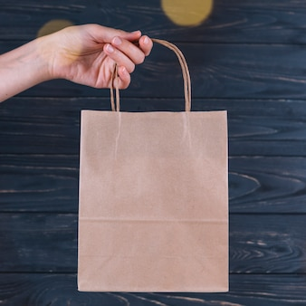Woman holding gift bag in hand