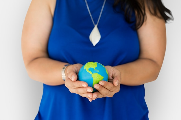 Woman holding global ball in her hands