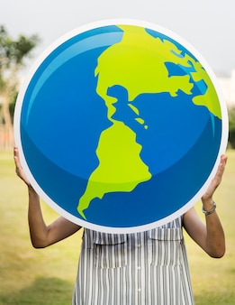 Woman holding a globe in our hands