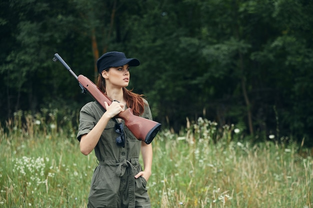 Woman holding a gun outdoors