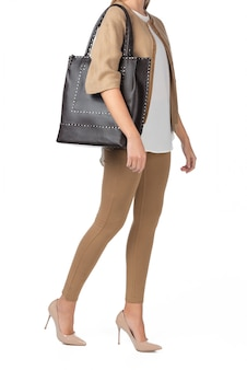 Woman holding a handbag isolated on white
