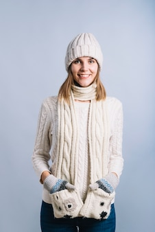 Woman holding hands in scarf pockets