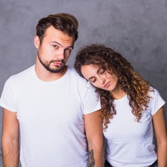Woman holding head on man shoulder