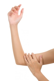 Woman holding her arm with massaging in pain area isolated on white