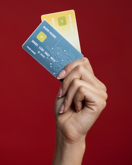 Woman holding her credit cards close-up