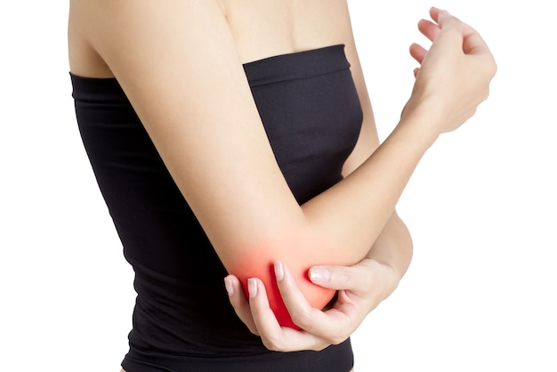 Woman holding her elbow with red highlight in pain area- isolated on white background.