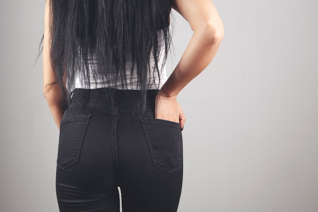 Woman holding her hand in her back pocket