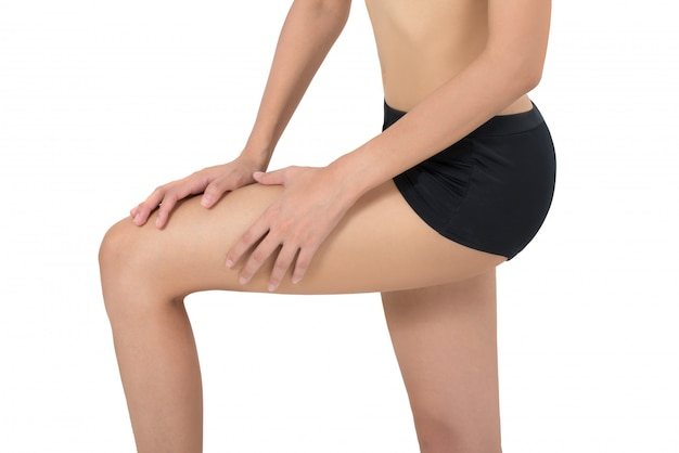 Woman holding her leg with massaging knee and calf in pain areas isolated on white