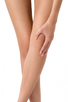 Woman holding her leg with massaging knee in pain areas isolated on white